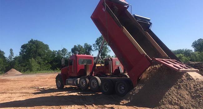 Dump-truck-dumping-dirt